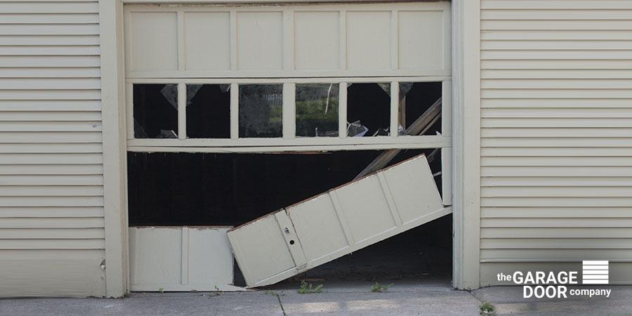 Broken Garage Door Needing Maintenance and Replacement