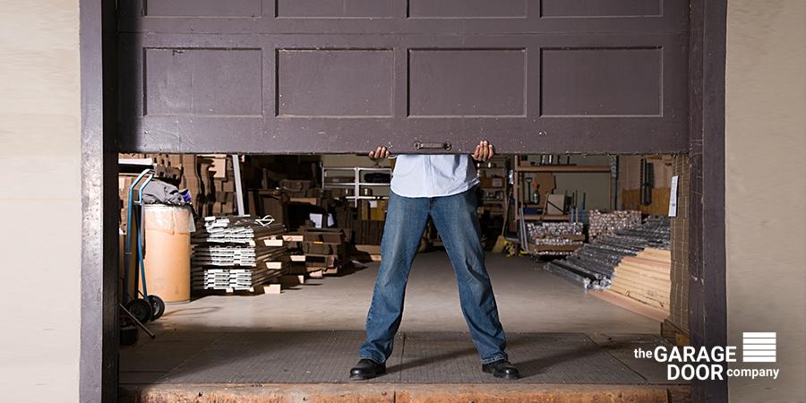 Man Lifting Garage Door by Hand