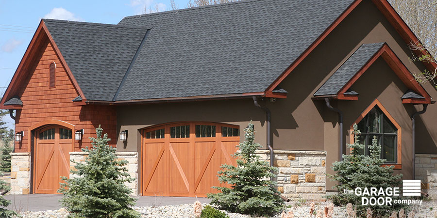 Wooden Garage Door Matching House Exterior