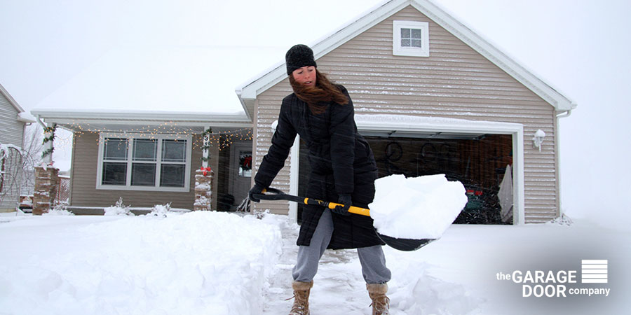 Winter Cleaning Snow in Front of Their Garage