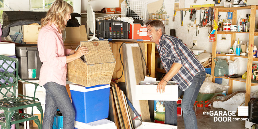 Couple Organizing Garage Stuff