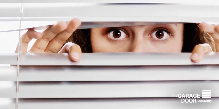 Girl Hiding behind the blinds